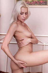 Platinum blonde babe Viviene exposes her peachy ass and smooth slim pussy
