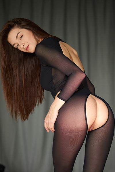 Packed in transparent black bodysuit this babe looks amazingly hot and sexy