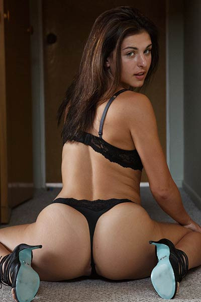 So hot girl with amazing curves Leah Gotti posing in sexy black lingerie
