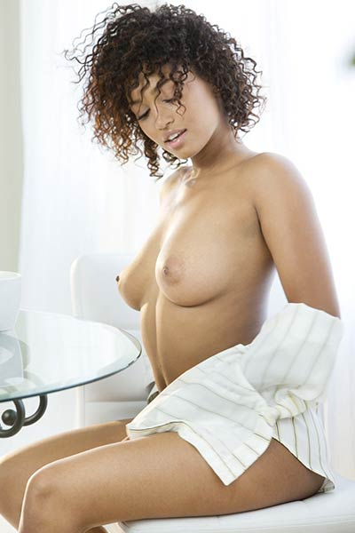Gorgeous Ebony vixen showcases her perfect posture while posing for a magazine