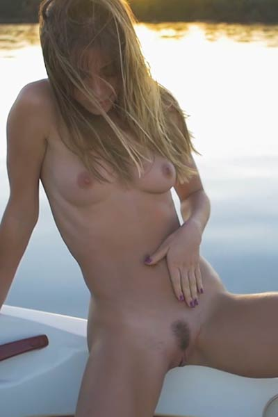 With a smile on her face Lilli bares her fruitful naked posture