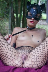 Kinky catwoman teasing with her sexy body packed in fishnets