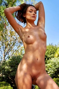 This super hot brunette is showing her tasty pussy in the garden