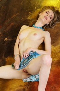 Skinny brunette Rebecca G takes off her blue dress on the floor