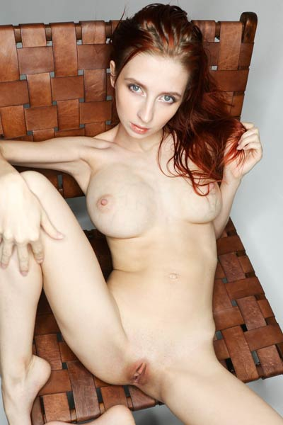 Fabulous Helga Grey seductively poses and gives us a perfect view of her massive breasts