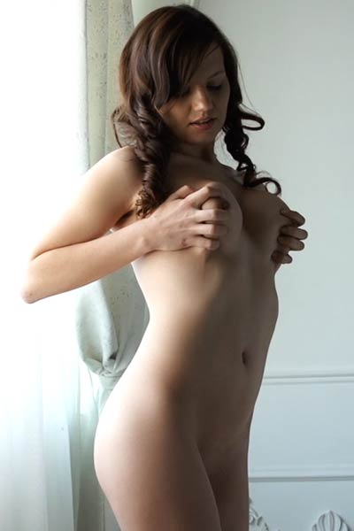 Brunette with silky skin teasing naked in many different poses