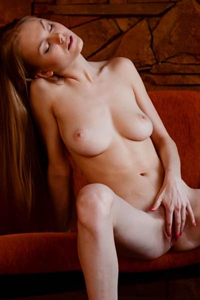 Skinny model with nice natural melons Nancy A masturbates on the red sofa