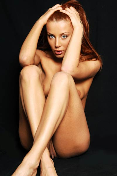 Redhead vixen gently strips naked showing off her amazing smooth and shiny body