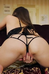 Graceful model Kira moves away her sexy black lingerie and masturbates on the couch