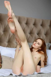 Stunning young redhead Bella strips off and poses just for you