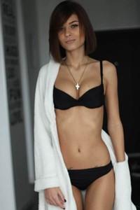 Super hot short haired brunette looks so sexy in that black lingerie