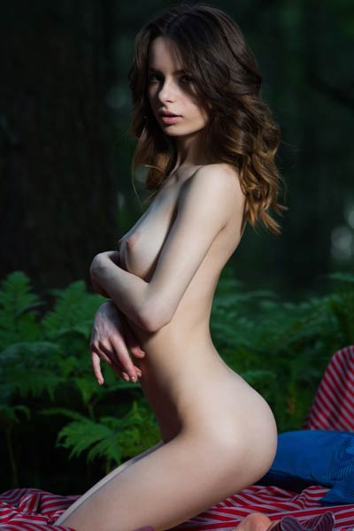 Debora A found a perfect place in the woods to enjoy stripping to the nude