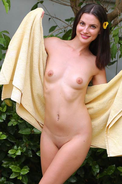 This cutie simply adores to spend her free time outdoors in backyard while totally naked