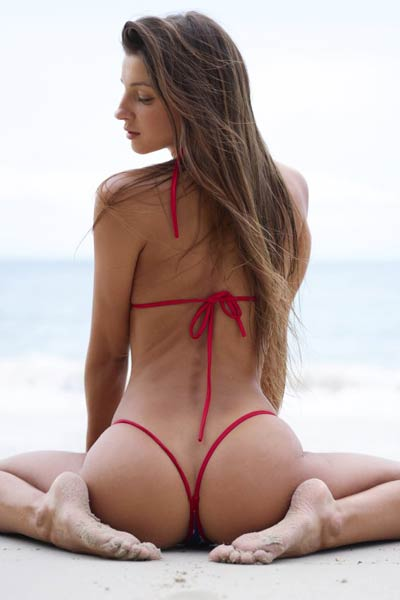 Burning hot Melena Maria poses naked on the beach in a sexy bikini showcasing her amazing ass