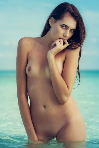 Nice photo set of beautiful brunette doll posing naked on her secret place