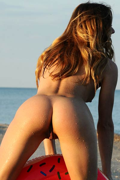 Spend amazing day on the beach with naughty brunette doll in nude