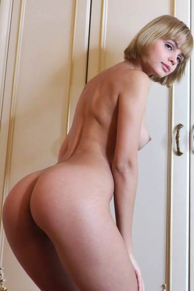 Stunning blonde takes off her underwear and poses naked