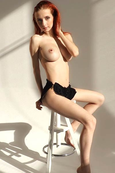 Big titted Helga Grey gets naked and poses on bar chair