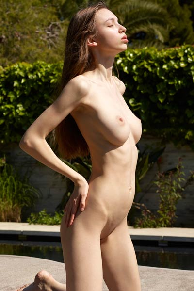 Pale and foxy beauty Aya Beshen seductively poses naked and bares her sweet body