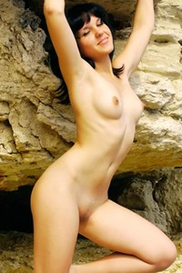 Kristy A is totally naked teasing in many different poses on the seashore