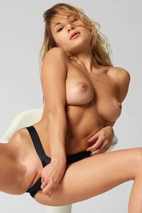 Perfectly shaped babe Darina L sits in the chair and shows us some sexy poses naked