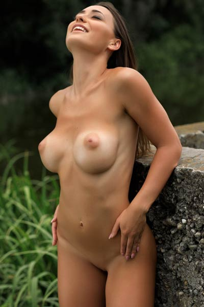 Magnificent brunette takes off her hot white bodysuit baring her amazing big breasts