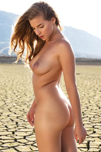 Perfectly shaped Heather stuns everyone with her seductive body as she poses in desert
