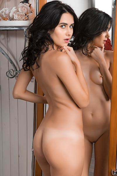 Pure black haired young lady looks so sexy striping off in her house