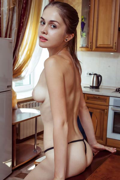 Maria Espen is in her kitchen stripping off her jeans and shirt to show you her naked body