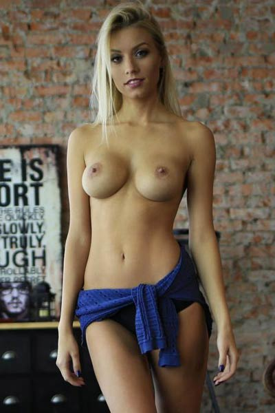 Cute but foxy blondie KillerQ takes off her sweater baring her lickable tits