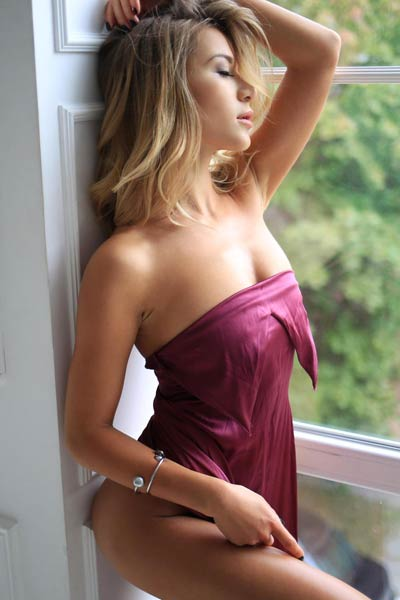 Angelic blonde babe DaleeQ seductively poses in elegant velvet dress showing off her perfect figure