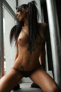 So seductive tattooed babe SunnyQ uninhibitedly poses in the workshop