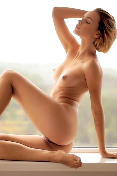 Amazing young short haired blonde Ariel gives us amazing naked posing