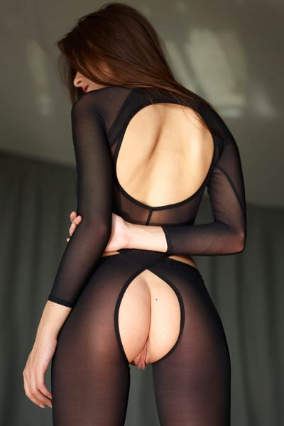 Sexy brunette vixen poses in her crotchless bodysuit flashing her meaty muff