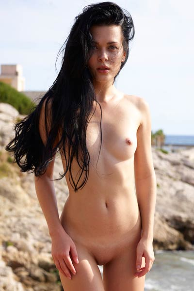Dark haired goddess Belle is not shy to show us perfect naked body in public