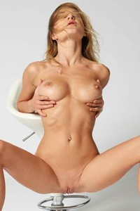 Lustful blonde chick gives us a glint of her love holes as she poses in the chair