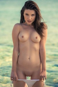 Good looking brunette Serena Wood gives us nice view of her body on seaside