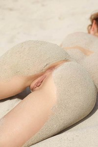 Great to see this young brunette Jenna getting all dirty of sand