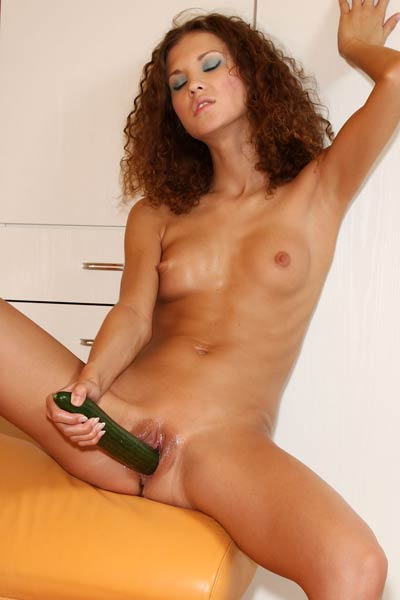 Masturbating with vegetables is what this naughty brunette prefers