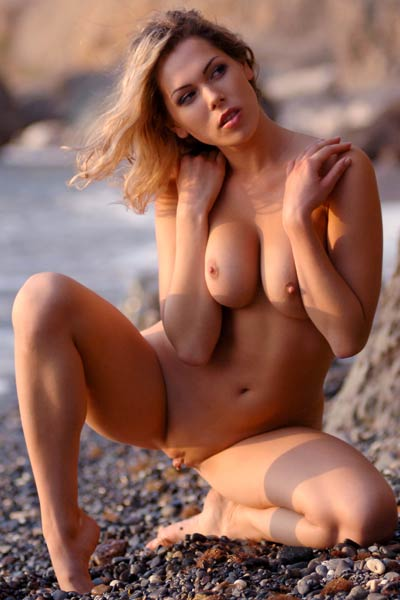 Good looking young Malvina goes wild with naked posing for you