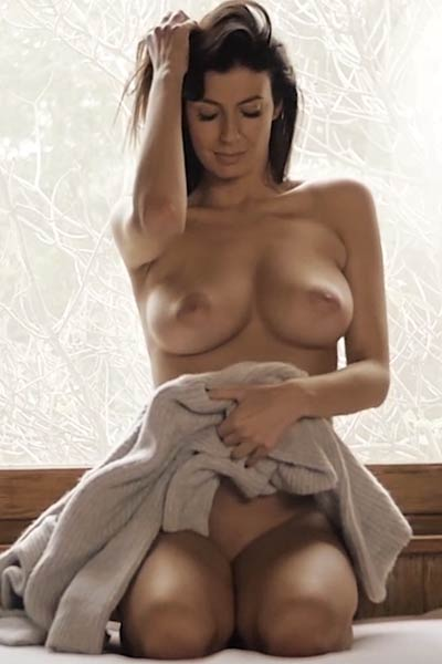Young light skinned chick takes off her clothes and big boobs come out