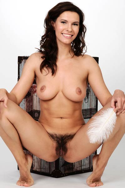 Young lady with nice body spreads her legs and shows us her hairy pussy
