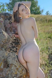 She is cute she is all natural and she likes to spend her time naked outdoors in nature