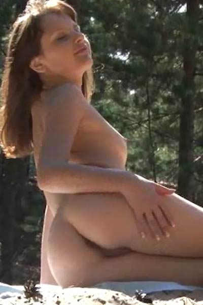All natural brunette Lily walks around the beach naked baring her nubile body