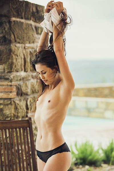 Good looking young lady Edessa G goes wild with her sensual posing