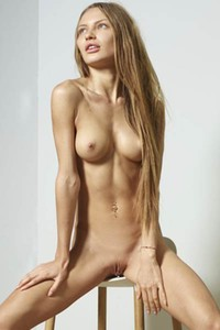 Magnificent Jolie sits on the chair naked and presents her amazing tight body
