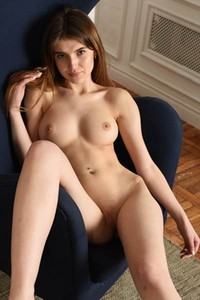 Take a break and get in the living room where well curved brunette is waiting you in nude
