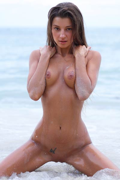 Beautiful doll Melena Maria fingers her wet love hole on the beach
