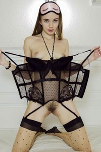 Delicious darling looks irresistible in stockings garters and sexy black lingerie