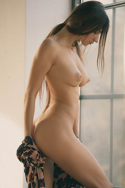 Young good looking chick with nice body goes wild in sensual posing